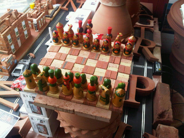 Terracotta Mini Brick Chess Set  with wood playing pieces for illustrative purposes.