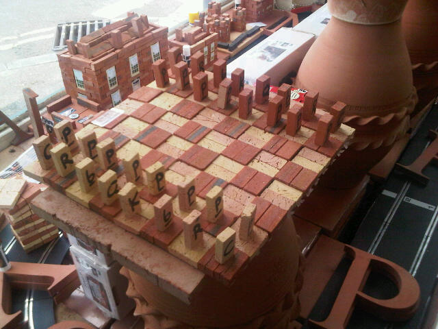 Terracotta Mini Brick Chess Set with mini brick lettered playing pieces.