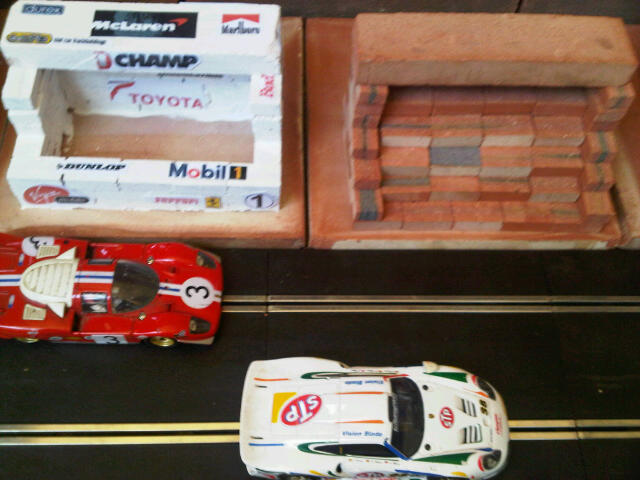 Scalextric Pits. Also Control Building, Restaurant, Grandstand. Similar to original range of plastic Scalextric Goodwood race buildings but in clay - built from mini bricks, painted (or not) and decals added.