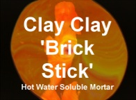 The ClayClay 'BrickStick' Mortar, 10g. Dissolve building in hot water. Bricks can be used again