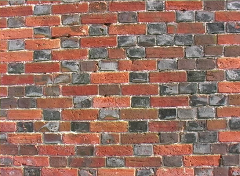 Wikipedia Description of what a brick is . This picture shows Brickwork using a 'Flemish' bond  with glazed headers and 18th century 'orangy red' handmade brick. EspadaRolls!