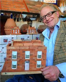 Tim Bristow, of Clay Clay, with a miniature clay brick building of a Georgian mansion. Picture by Peter Boam. Isle of Wight County Press Article 29th April 2011