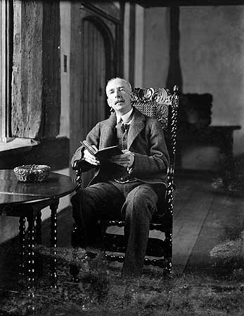 Nathaniel Lloyd reading at Great Dixter, photographed in March 1921 when he was 54 years old.