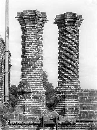 The fashion for chimneys in the Tudor period was for elaborate decoration using both cut and purpose-moulded brick. This example of spiral decoration at Layer Marney Hall is typical.