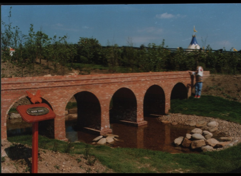 3 year old Arthur Bristow standing next to Model aquaduct made with York Handmade Mini Bricks at Gateshead Garden Festival 1990