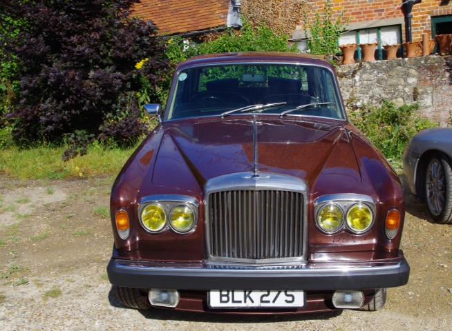 Walnut over Silver Sands Bentley T2. 1978. One of only 548 Bentleys made of Shadow 2 shape (over 12,000 RR Shadows made) Chassis No SBH 32376  Genuine 120,500 miles.  Extensive history and service records. Full brake overhaul and recon gearbox prior to recommssioning July 2015 Interior brown leather  MOT July 2017 Very original and a much appreciating investment particlualry as Bentley T2 are so rare. Over £8,950